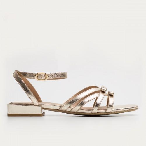 Złote sandały z kokardkami
